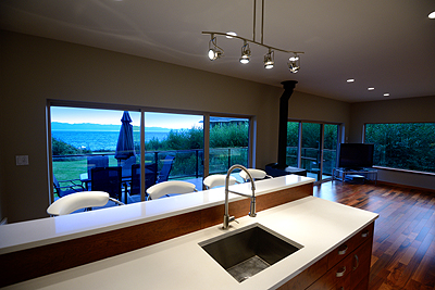 Select units feature full kitchens with gas range and stainless steel appliances