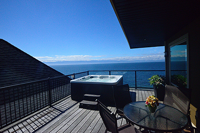 640 sq ft private deck with hot tub, recliners and gas BBQ