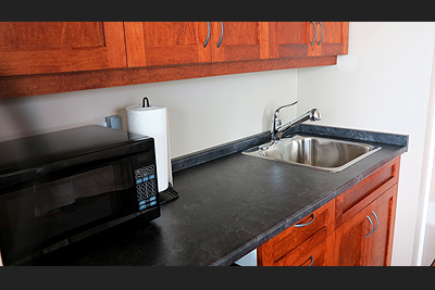 Each unit features a kitchenette with microwave, fridge, sink, coffee maker, kettle, dishes and utensils